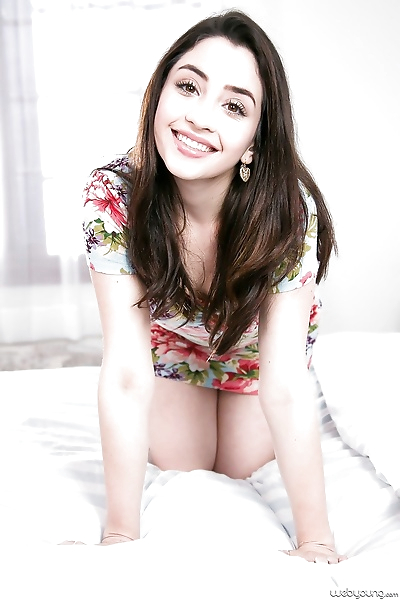 Adorable young brunette Eva..