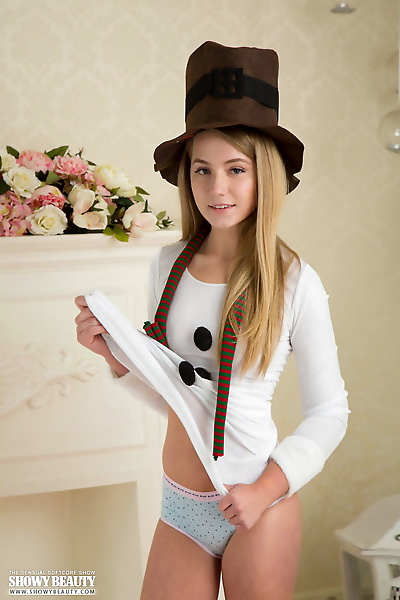 Adorable teen Viva removes her hat and clothes for her totally nude debut